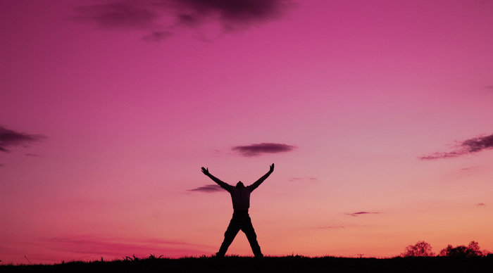 Scaled_man-enjoying-freedom-pink-sky-pictures