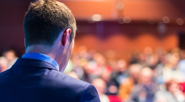 Scaled_bigstock-speaker-at-business-conference-64962394
